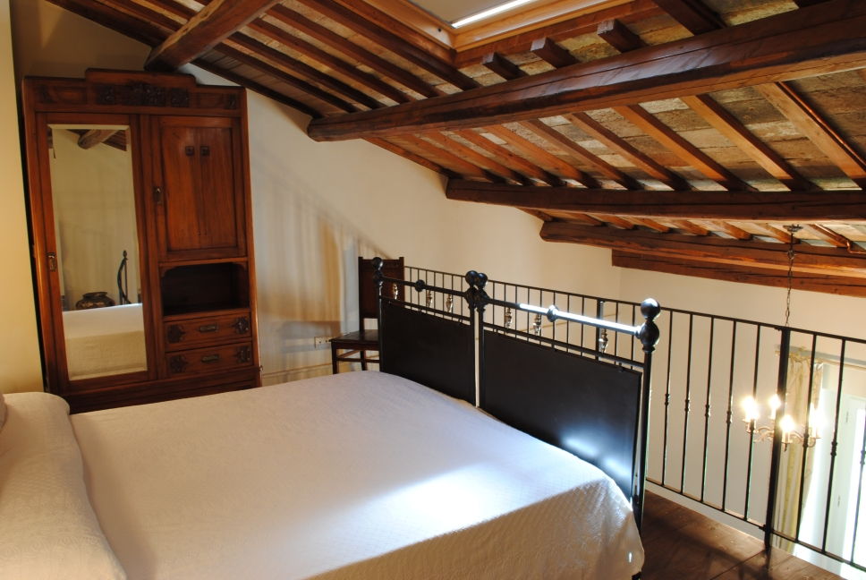 Double bed on a loft